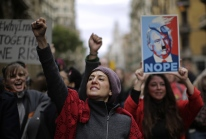 People shouts slogans during the Women's March rally in Barcelona, Spain, Saturday, Jan. 21, 2017. The march was held in solidarity with the Women's March on Washington, advocating women's rights and opposing Donald Trump's presidency. (AP Photo/Manu Fernandez)